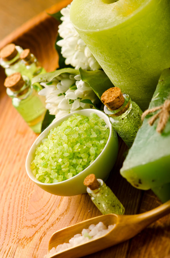 Spa. Green sea salt. Spa scene with close-up of green sea salt stock photo