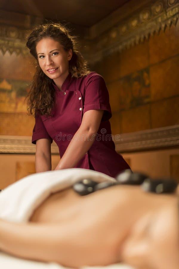 Spa hot stone massage royalty free stock photos