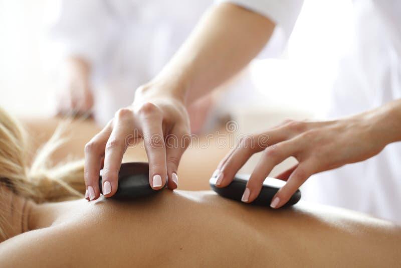 Spa hot stone massage stock photography
