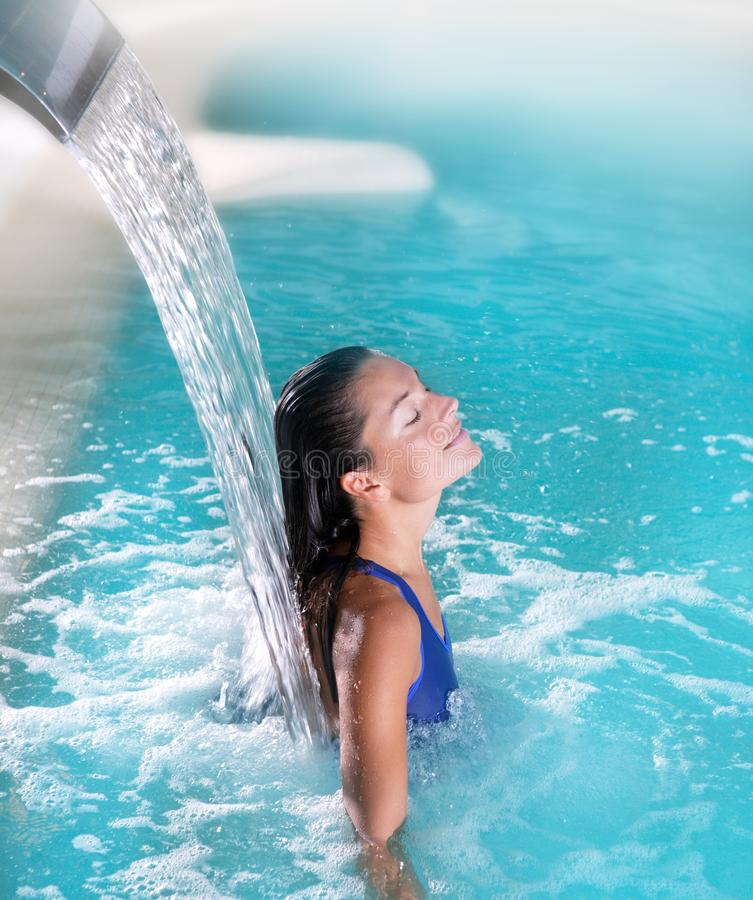 Spa hydrotherapy woman waterfall jet royalty free stock photography