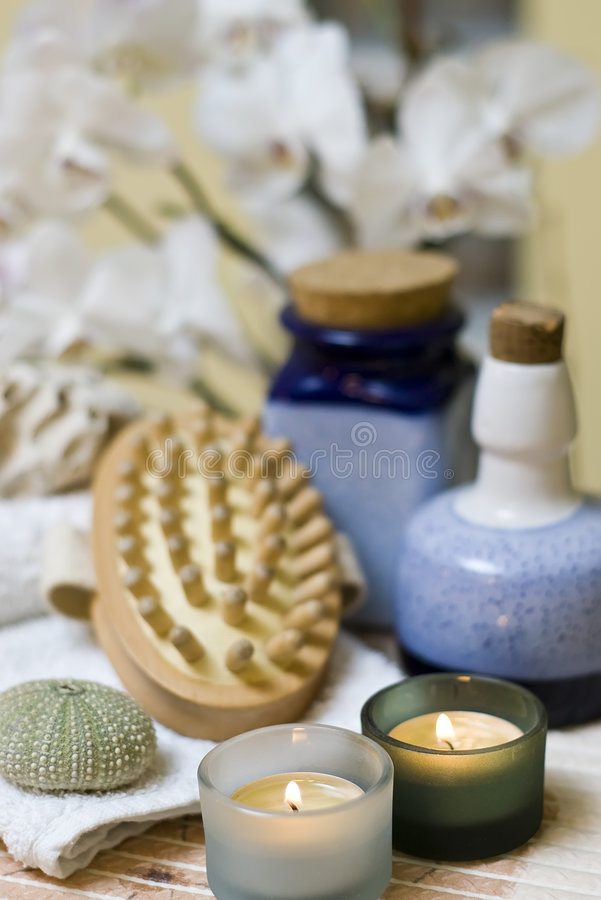 Spa items composition. A set of spa items with a massage brush and candles stock photography