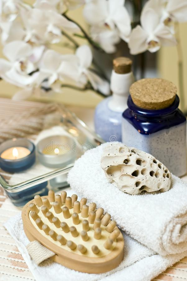Spa items composition. A spa massage brush with a towel, decorative composition royalty free stock images