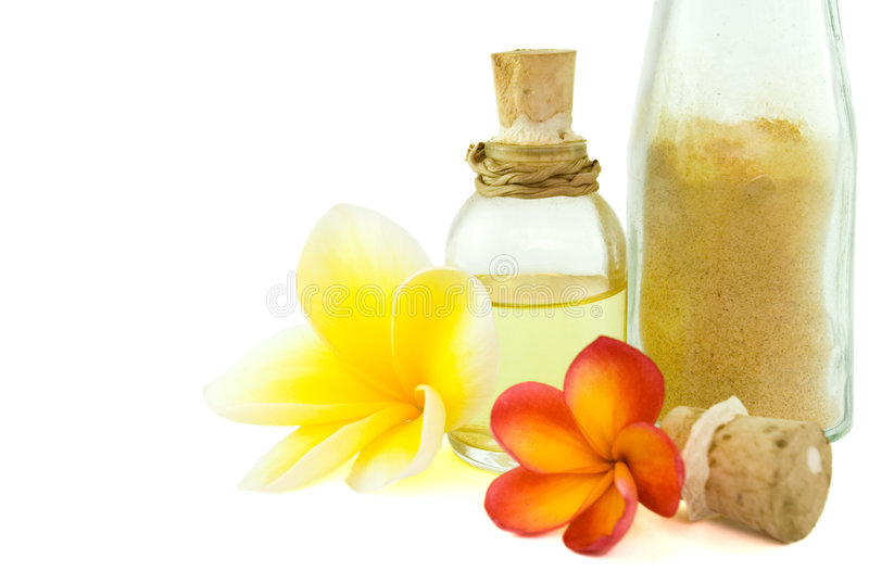 Spa items and tropical flowers royalty free stock images