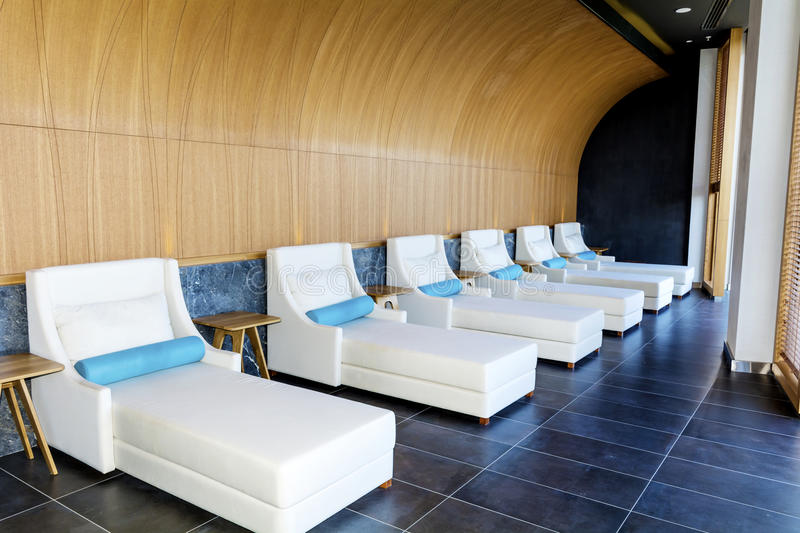 Spa luxury resort pool area. Hotel Spa luxury resort pool area with white lounge chairs stock photo
