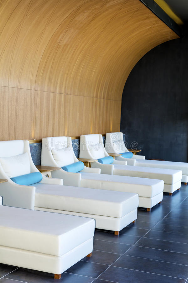 Spa luxury resort pool area. Hotel Spa luxury resort pool area with white lounge chairs royalty free stock images