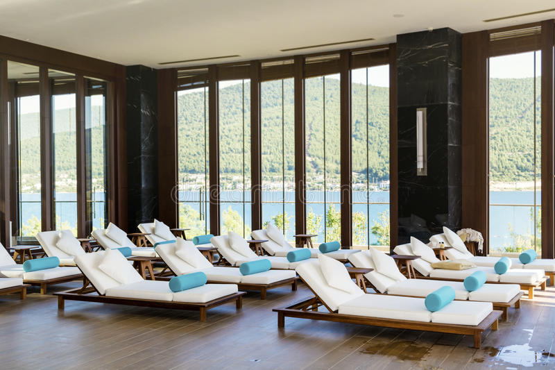 Spa luxury resort pool area. Hotel Spa luxury resort pool area with white lounge chairs stock photos