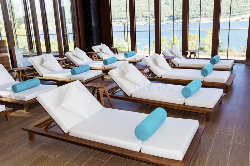 Spa luxury resort pool area. Hotel Spa luxury resort pool area with white lounge chairs royalty free stock photography