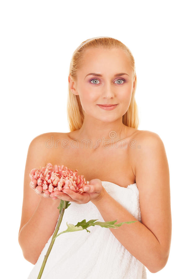 Spa makes you look like a flower. Girl with flower on isolated white stock image