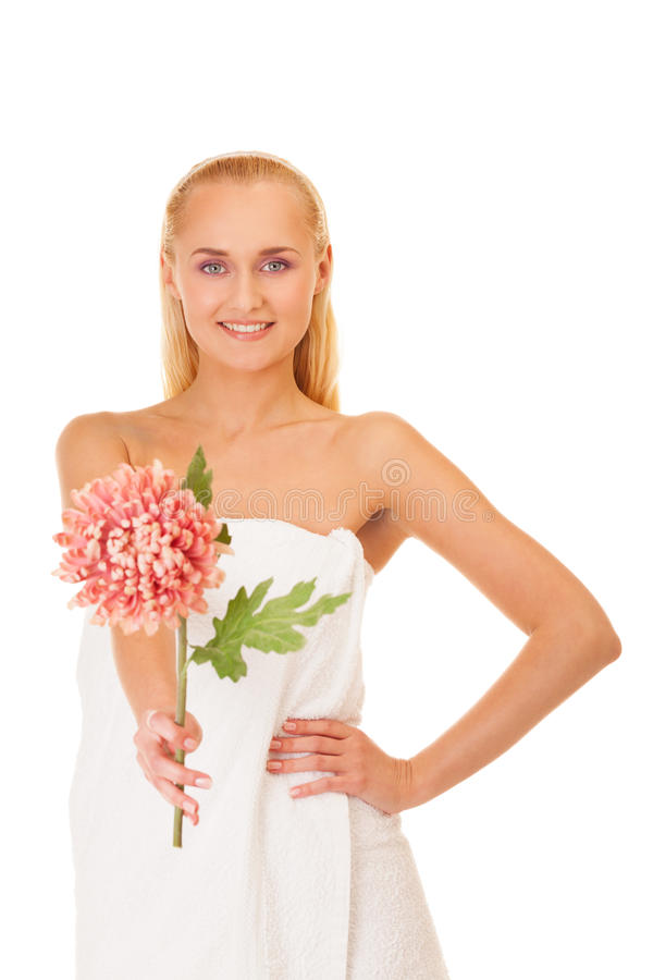 Spa makes you look like a flower. Woman wrapped in a towel with flower on isolated white royalty free stock image