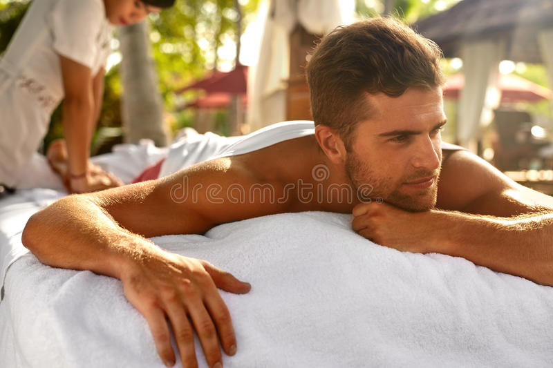 Spa For Man. Happy Male Relaxing Outdoors At Day Spa. Spa For Man. Beautiful Healthy Happy Male Model Relaxing At Day Spa Beauty Salon. Handsome Guy Enjoying stock images