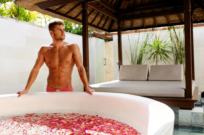 Spa Man Near Relaxing Bath On Summer Day Outdoors. Relax royalty free stock photo