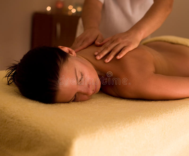 Spa Massage. Woman getting massage at spa center royalty free stock image