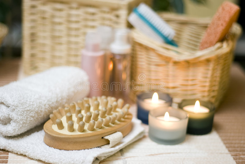 Spa massage. White towel with a spa massage brush composition royalty free stock photography