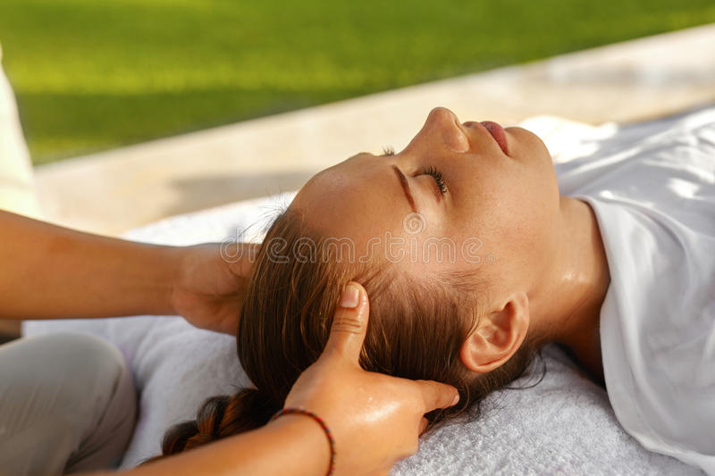 Spa Massage. Beautiful Woman Enjoying Head Massage. Body Care. Spa Massage. Masseur Hand Massaging Girl's Head With Aromatherapy Oil. Closeup Of Beautiful royalty free stock images