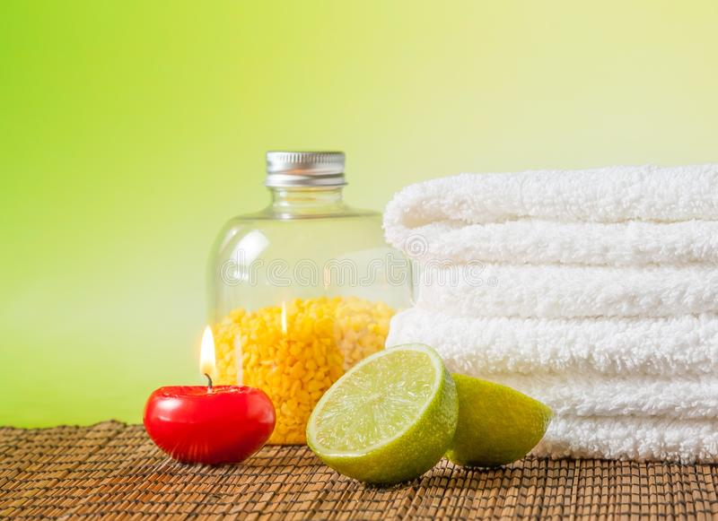Spa massage border background with towel stacked,red candle and lime stock image