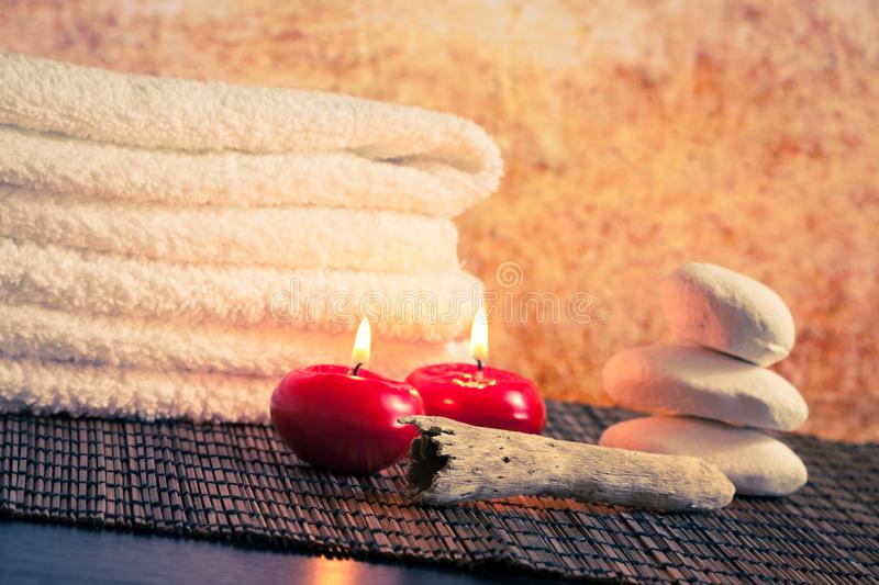Spa Massage Border Background With Towel Stacked Stone And Red Candles Stock Photo