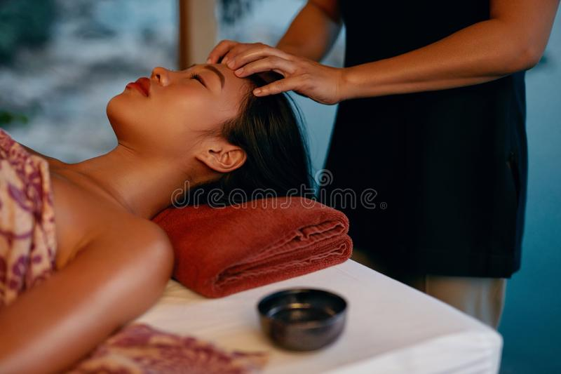 Spa Massage. Hands Massaging Woman Head At Thai Beauty Salon royalty free stock photography