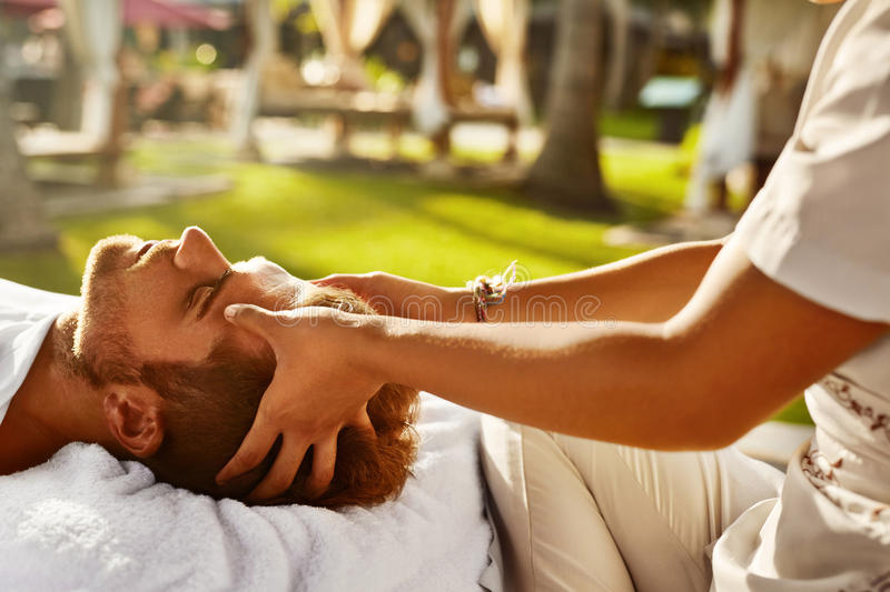 Spa Massage. Man Enjoying Relaxing Head Massage Outdoors. Beauty. Spa Massage. Closeup Of Beautiful Healthy Happy Man Enjoying Relaxing Head Massage At Outdoor stock image