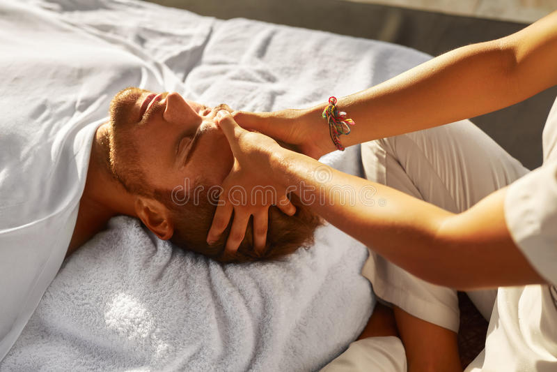 Spa Massage. Man Enjoying Relaxing Head Massage Outdoors. Beauty. Spa Massage. Closeup Of Beautiful Healthy Happy Man Enjoying Relaxing Head Massage At Outdoor stock photo