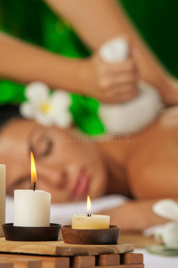 Spa massage. Portrait of young beautiful woman in spa environment. focused on candles royalty free stock photo