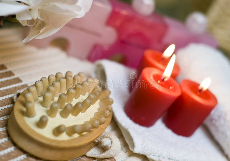 Spa massage and red candles. A set of spa items with a massage brush and red candles royalty free stock images