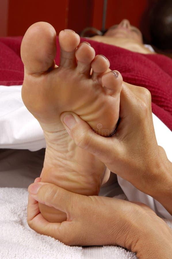 Spa Massage Reflexology. Reflexology foot massage treatment at day spa salon royalty free stock image