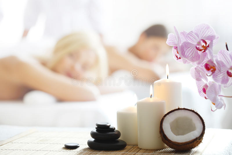 Spa massage. Tools and women getting massage on background