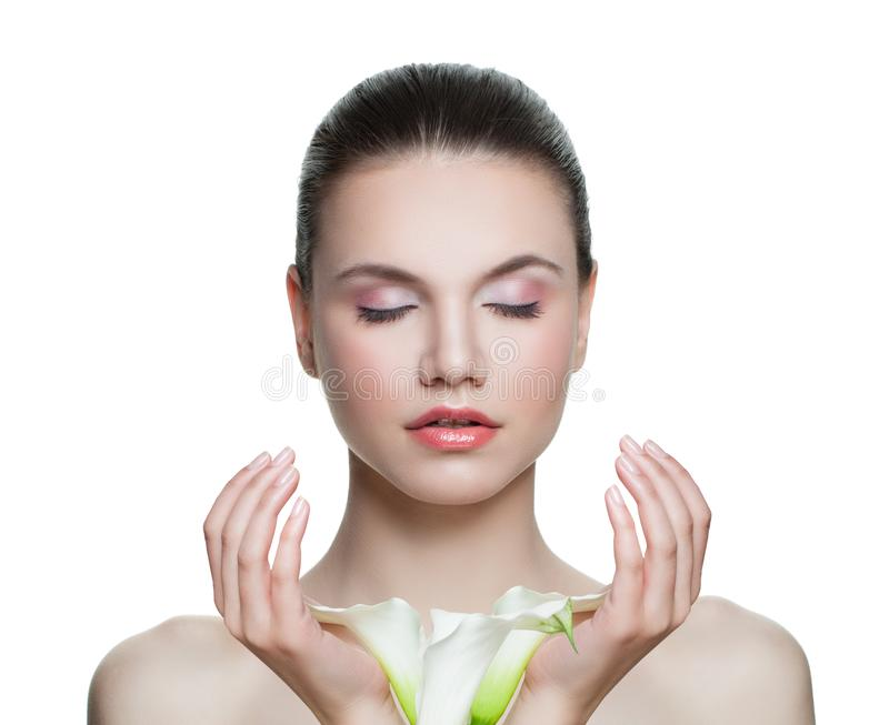 Spa model woman with clear skin and flowers in hands isolated on white. Spa beauty portrait stock photos