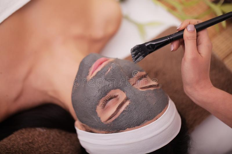 Spa Mud Mask. Woman in Spa Salon. Face Mask. Facial Clay Mask. Treatment stock images