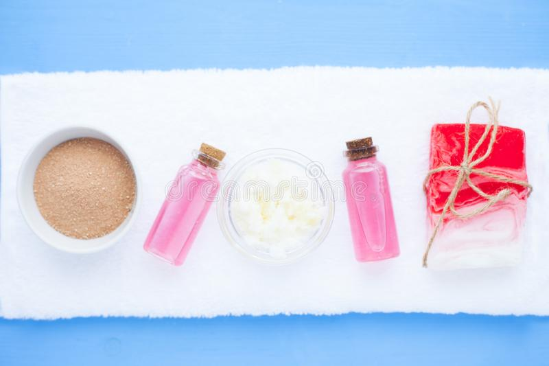 Spa and natural cosmetics concept. Set of skin and body care tools: shea oil, seashells, sponges, soap, clay and seaweed on the bright background. Top view stock images