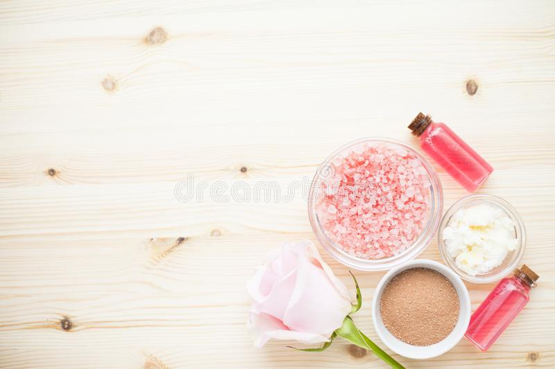 Spa and natural cosmetics concept. Set of skin and body care tools: shea oil, seashells, sponges, soap, clay and seaweed on the bright background. Top view royalty free stock photos