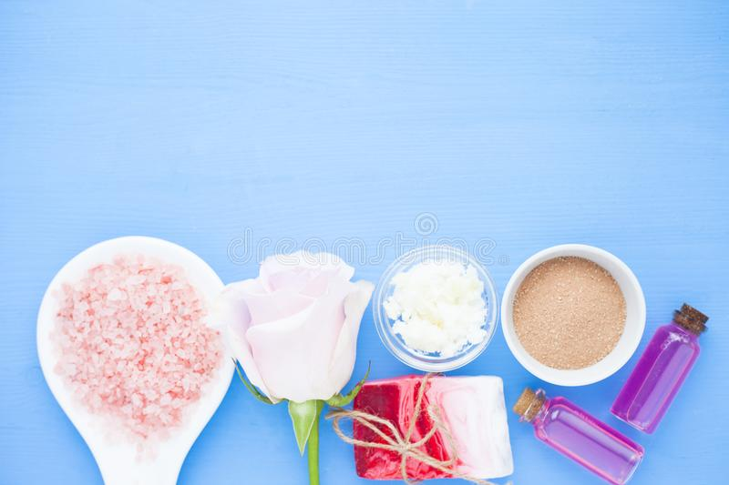 Spa and natural cosmetics concept. Set of skin and body care tools: shea oil, seashells, sponges, soap, clay and seaweed on the white background. Top view stock images