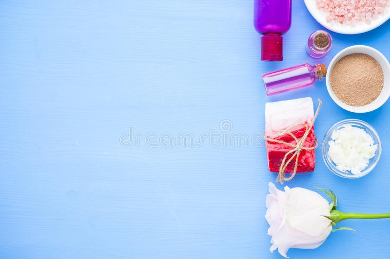 Spa and natural cosmetics concept. Set of skin and body care tools: shea oil, seashells, sponges, soap, clay and seaweed on the white background. Top view royalty free stock photo