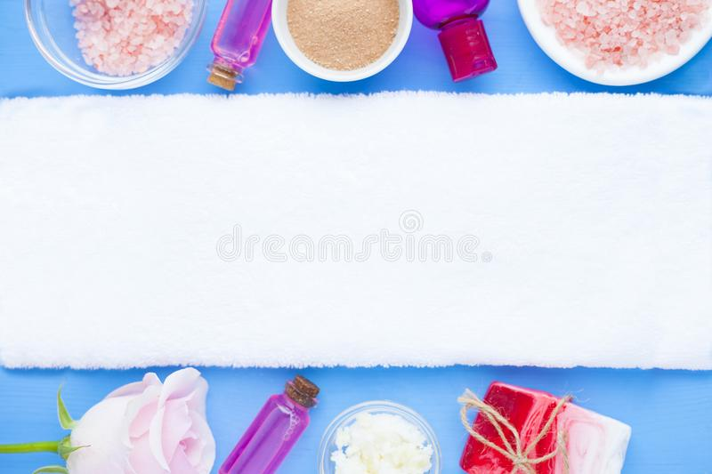 Spa and natural cosmetics concept. Set of skin and body care tools: shea oil, seashells, sponges, soap, clay and seaweed on the bright background. Top view stock photos