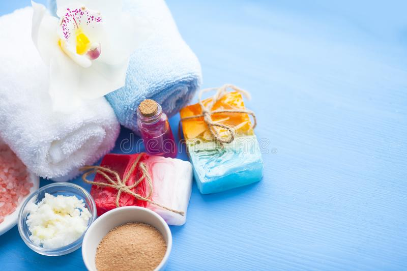 Spa and natural cosmetics concept. Set of skin and body care tools: shea oil, seashells, sponges, soap, clay and seaweed on the bright background. Top view stock photo