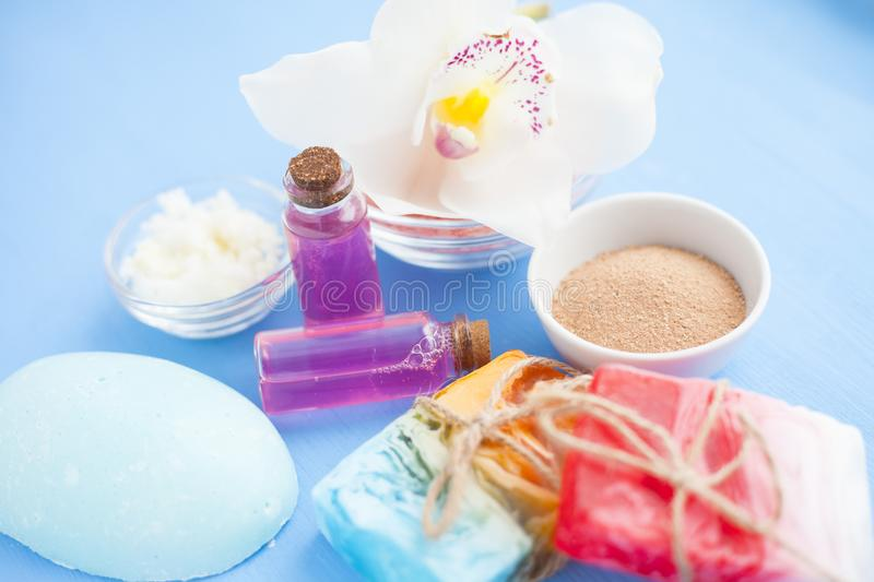 Spa and natural cosmetics concept. Set of skin and body care tools: shea oil, seashells, sponges, soap, clay and seaweed on the bright background. Top view royalty free stock images