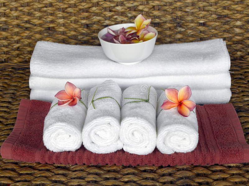 Spa objects. With tropical flowers on natural texture stock photos