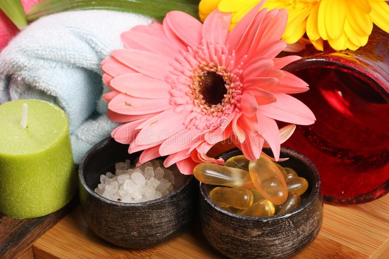 Spa oil capsules and salt royalty free stock photos