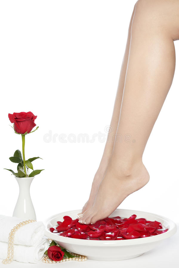 Spa Pedicure Set Feet with Ceramic White Bowl and Red Rose royalty free stock image