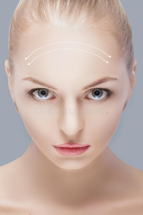 Spa portrait of attractive woman with arrows on face Face lifting concept. Plastic surgery treatment, medicine stock photos