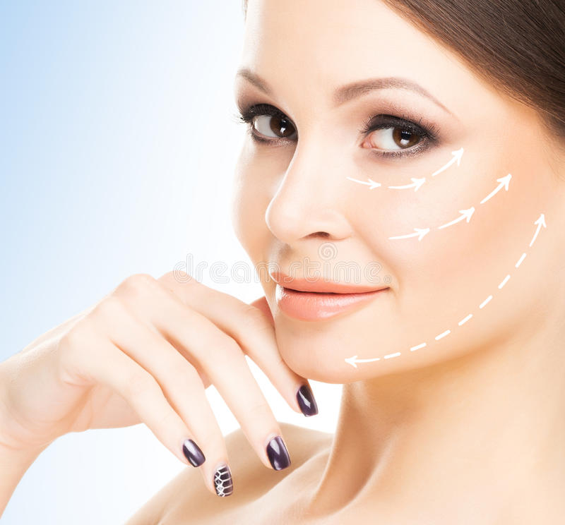 Spa portrait of an attractive, young and woman with arrows on he royalty free stock photo