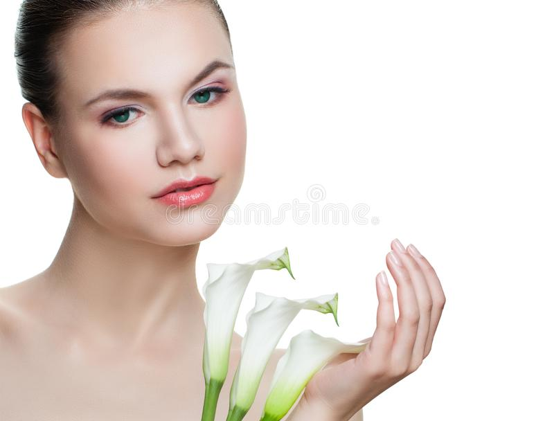 Spa portrait of beautiful female face isolated on white background. Nice girl with white flowers royalty free stock photos