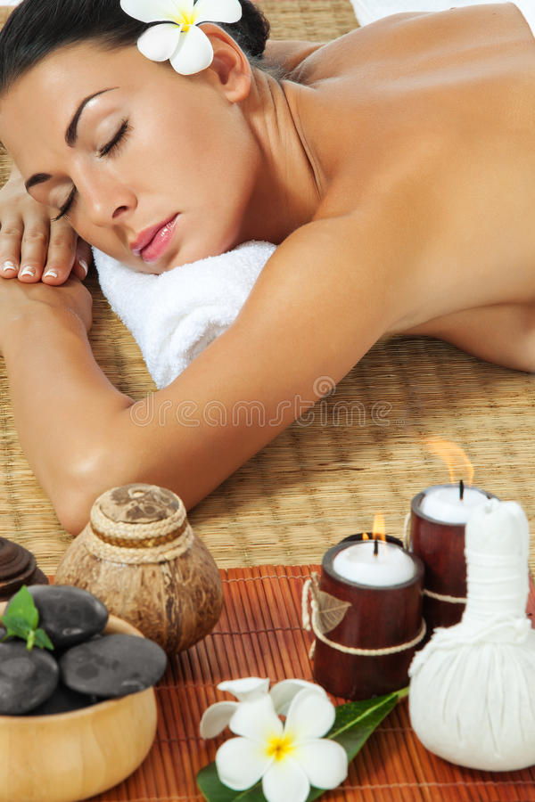 In spa. Portrait of young beautiful woman on color back stock image