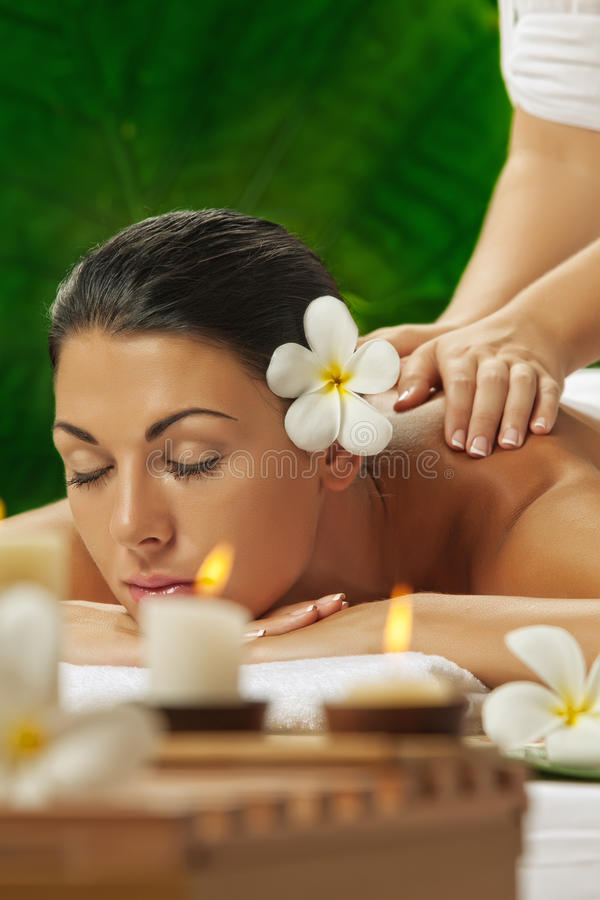 In spa. Portrait of young beautiful woman in spa environment stock photo
