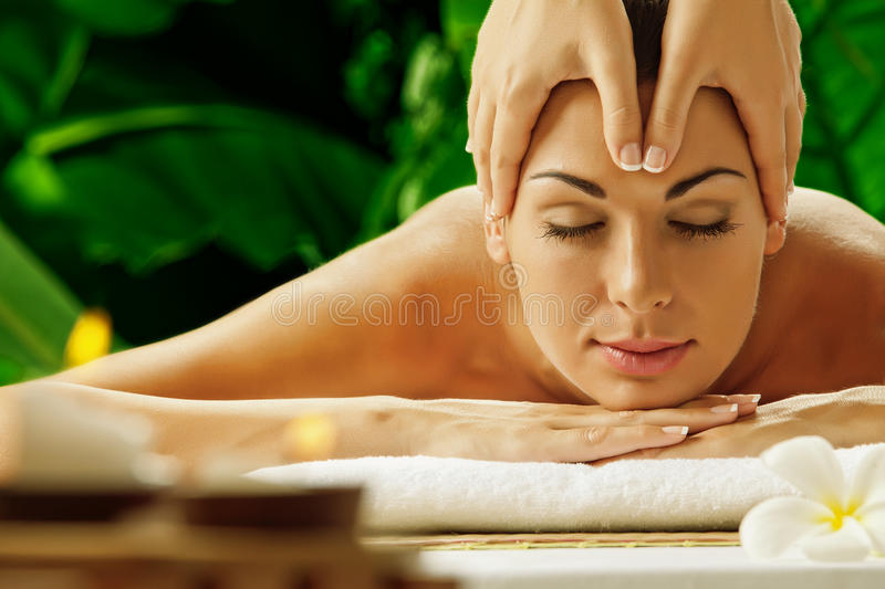 In spa. Portrait of young beautiful woman in spa environment stock photos