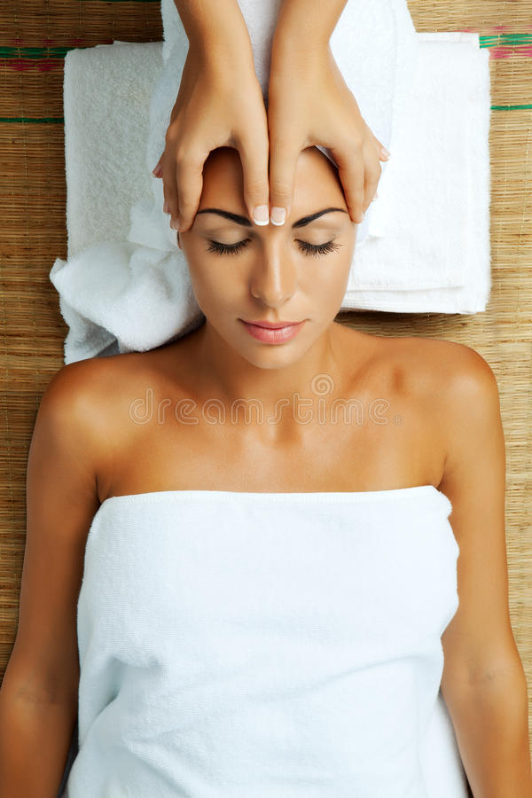 In spa. Portrait of young beautiful woman in spa environment stock image