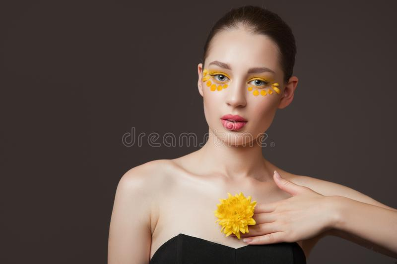 Spa portrait of a young woman. Flowers on her face. The concept of skin and body care. Perfect skin health stock photography