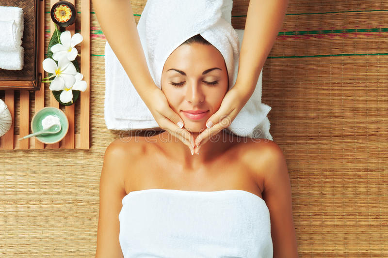Spa procedure. Portrait of young beautiful woman in spa environment royalty free stock photo