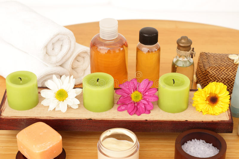 Spa Products. Like scented soap, candles, bath salt, body cream, towels, essential and massage oils with flowers on display, part of a luxurious spa treatment royalty free stock photo