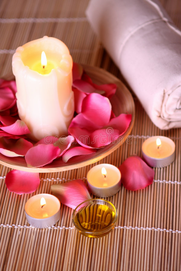 Spa products with rose petals, oil, towel stock photos